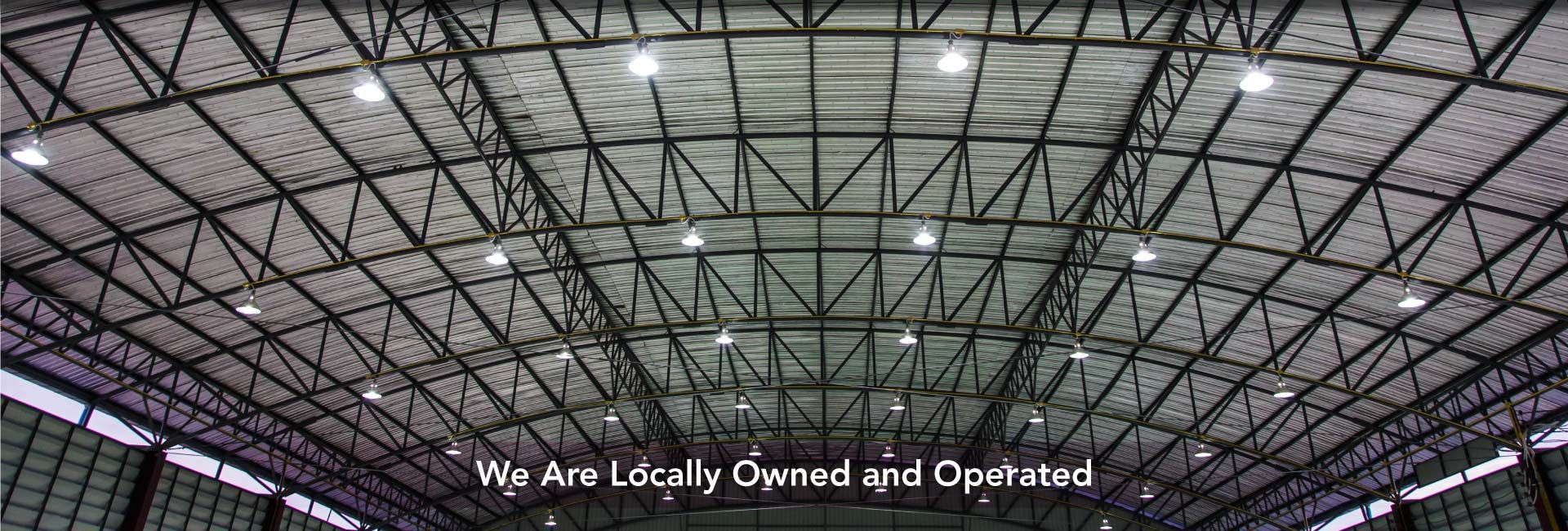 We Are Locally Owned and Operated | Metal sheet roof of indoor stadium